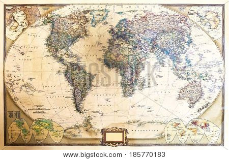 Detailed world map with two hemispheres which depicts the continents seas oceans names of countries their capitals and cities.