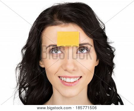 Closeup of a Woman with Adhesive Note on the Forehead