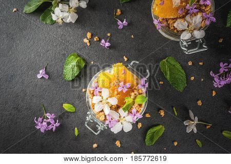Yoghurt With Granola, Orange, Mint And Edible Flowers
