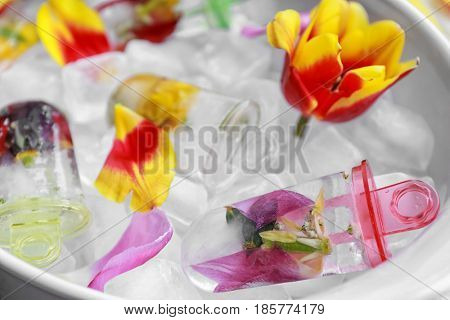 Homemade popsicles with flowers in serving dish