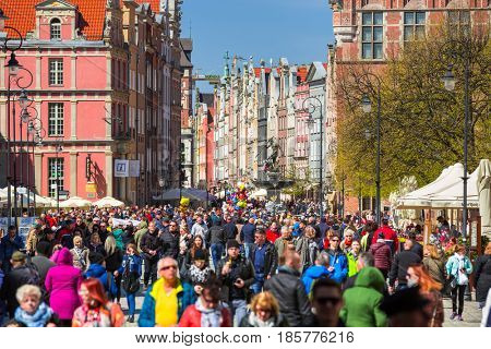 GDANSK, POLAND - MAY 2, 2016: People on the Long Lane street in old town of Gdansk, Poland. Baroque architecture of the Long Lane is one of the most notable tourist attractions of the city.