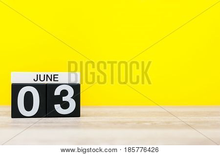 June 3rd. Day 3 of month, calendar on yellow background. Summer day, empty space for text.