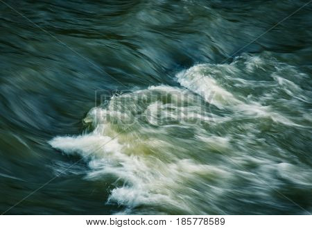 abstract background light on the dark river rapids