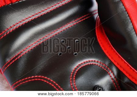 Red boxing gloves inside with vent hole close up detail.