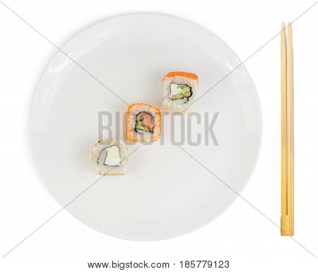 Sushi rolls in plate with chopsticks isolated on white background