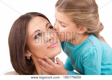 Closeup of a Young Daughter Kissing Her Mother