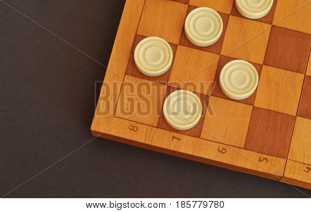 Sports or recreation Board game board with checkers. Hobby. Checkers on the playing field for the game.