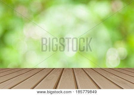 Wooden board empty table in front of blurred background. Perspective brown wood table over blurred trees with bokeh background - can be used mock up for display or montage your products. spring season.
