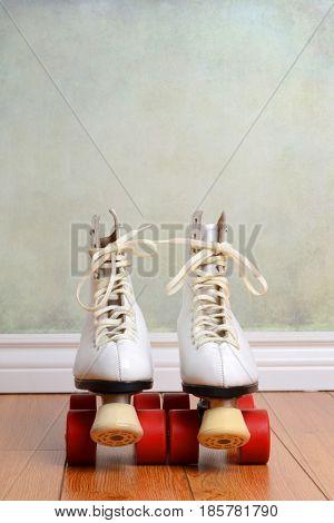 front view women quad roller skates on wood floor