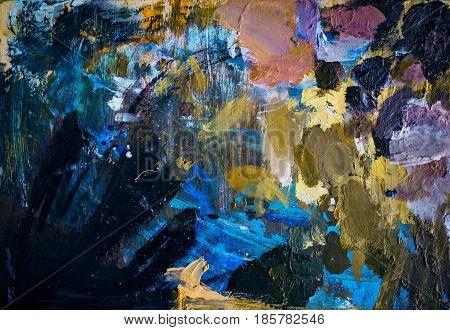 Colored oil paints over a pallete on a table. Painting concept. art paint palette.