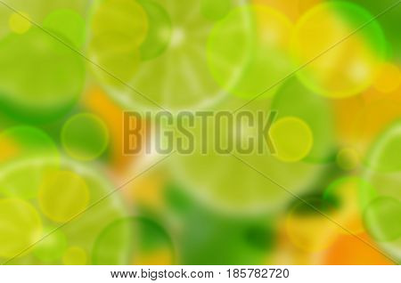The fruits are bright yellow-green blurred background. Fresh sliced citrus fruits background. Lime lemon orange.