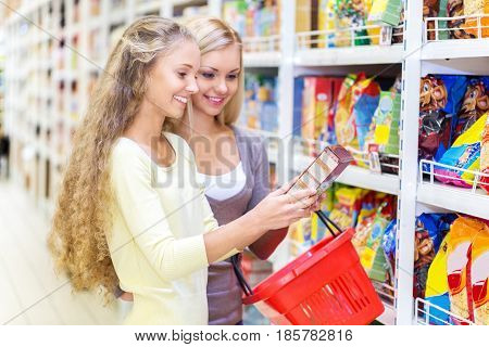 Portrait of Two Women Reading a Lable in a Supermarket