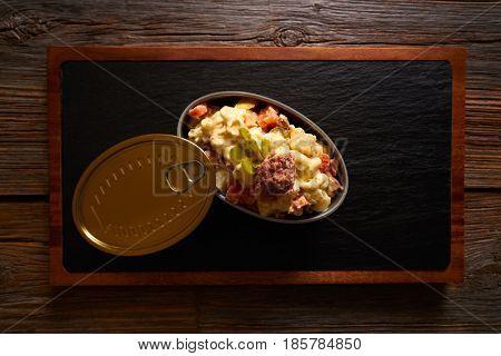 Tapas ensaladilla rusa is a potato salad with tuna mayonaise pickles