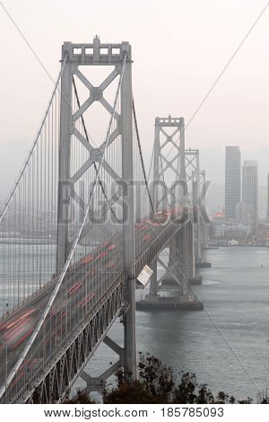 San Francisco's Bay Bridge Close-up on a Foggy Evening. Yerba Buena Island, San Francisco, California, USA.