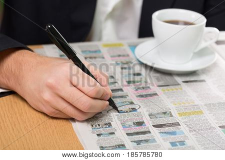 Closeup of a Person Looking at Classified Ads