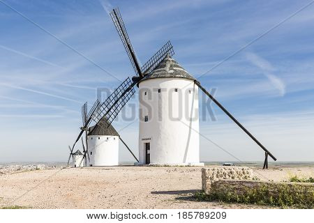white windmills in Alcazar de San Juan, province of Ciudad Real, Castilla-La Mancha, Spain