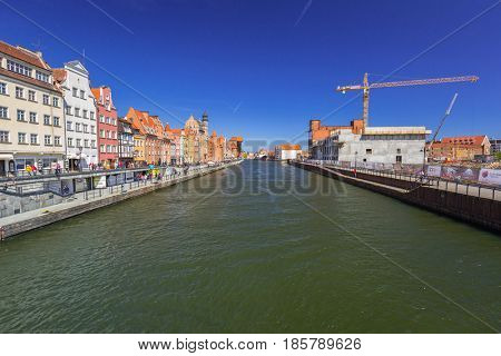 GDANSK, POLAND - MAY 2, 2017: Historic port crane at Motlawa river in Gdansk. Port crane in Gdansk built between 1442 and 1444 is the city symbol and the oldest surviving port crane in Europe.