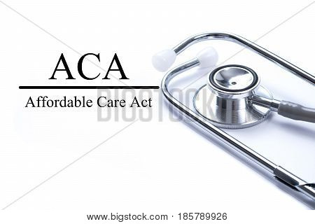 Page with ACA (Affordable Care Act) on the table with stethoscope medical concept