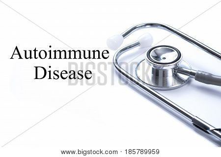 Page with Autoimmune Disease on the table with stethoscope medical concept.
