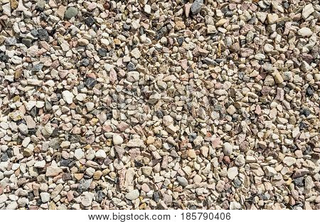 Stone background pebble stones texture Multi-colored stones background