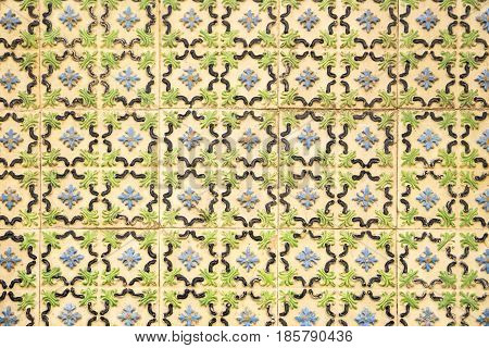pattern of ancient tiles with embossed flower shapes