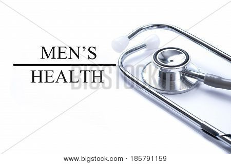 Page with Men's health on the table with stethoscope medical concept