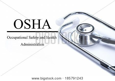 Page with Occupational Safety and Health Administration OSHA on the table with stethoscope medical concept
