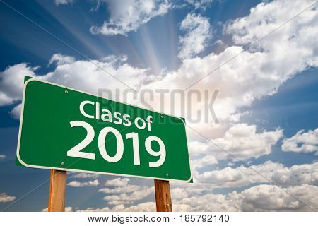 Class of 2019 Green Road Sign with Dramatic Clouds and Sky.