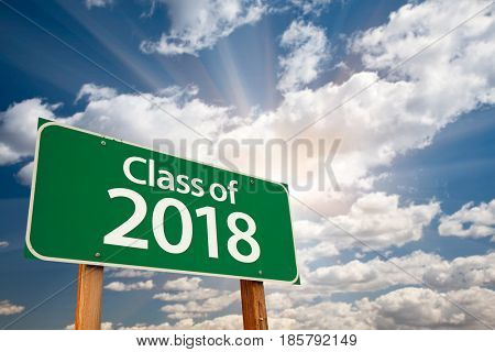 Class of 2018 Green Road Sign with Dramatic Clouds and Sky.