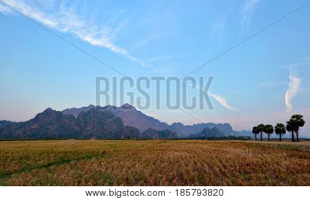 Beautiful panoramic view of Mount Zwegabin and harvested rice fields Hpa-An Myanmar (Burma)