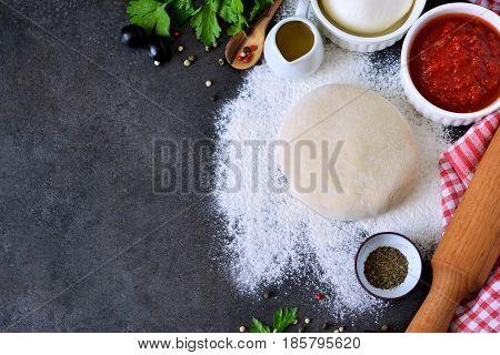 Ingredients for pizza: dough tomato sauce mozzarella basil. Pizza margarita.