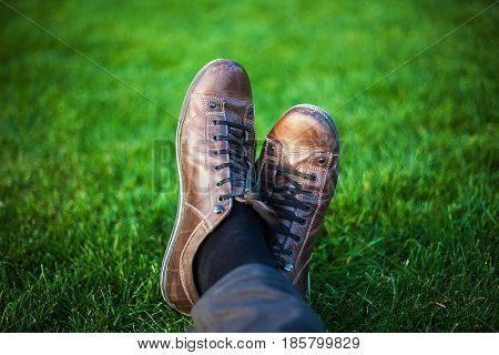 Legs In Shoes On Grass