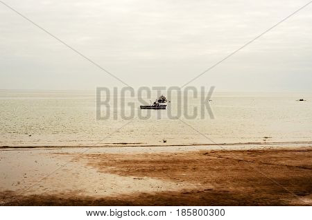 View From Shore On Fishing Boats In The Ocean, Beautiful Cloudy Day, Fishing Industry