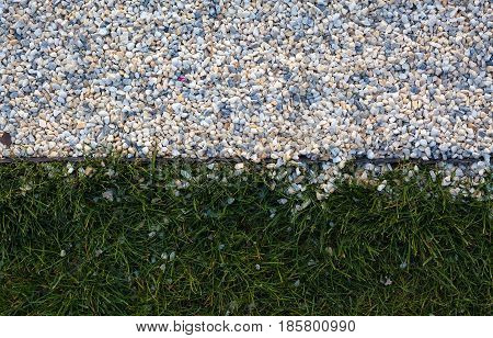 Abstract of gravel and grass textures, divided in the middle.