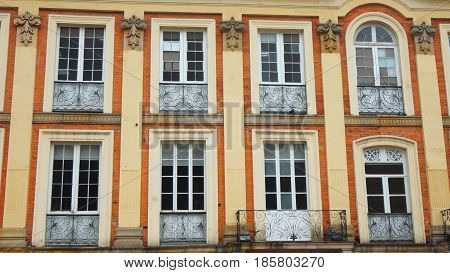 Closed windows on the front of old neoclassical building