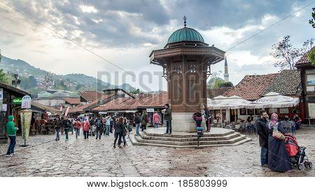 SARAJEVO, BOSNIA AND HERZEGOVINA - May 1 2014: Bascarsija square with Sebilj wooden fountain in Old Town Sarajevo, capital city of Bosnia and Herzegovina