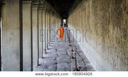 Siem Reap, Cambodia, December 06, 2015: Monk walking at a corridor in Angkor Wat, Cambodia