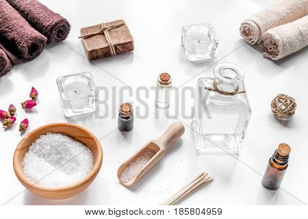 spa set with towels and organic soap on white table background