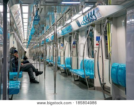Istanbul, Turkey - February 21, 2017: People in a train of istanbul Metro. The Istanbul Metropolitan is serving over 500 million passengers per year.