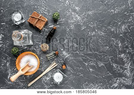 bathroom salt and natural soap for spa set on dark background top view mock-up