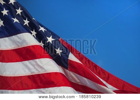 Flag of the USA. American flag. American flag blowing wind.