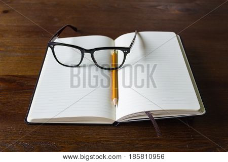Notebook With Pencil And Glasses