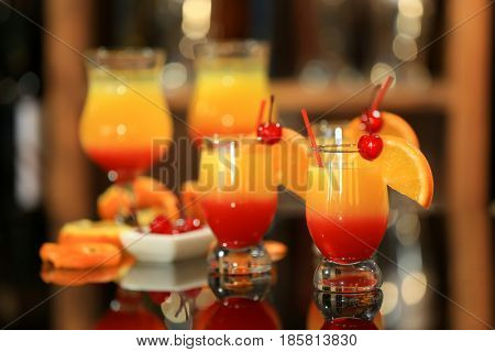 Tequila Sunrise cocktails in glasses on bar counter