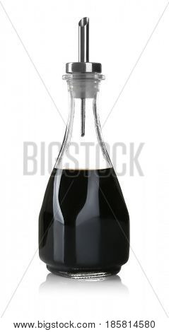 Bottle with tasty soy sauce on white background