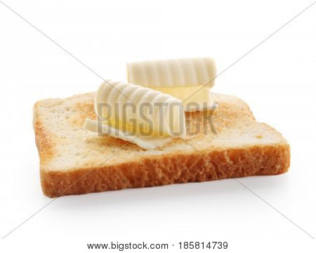 Slice of bread with butter curls on white background