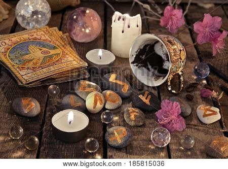 Mystic still life with coffee grounds, tarot cards and stone runes. Halloween background, coffee reading ritual, occult and esoteric objects on witch table