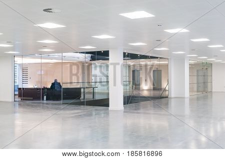 Solitary man in open plan office interior