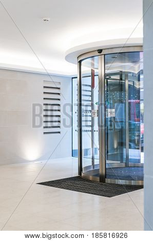 Shot looking outwards to revolving doors in modern office building
