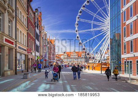 GDANSK, POLAND - MAY 2, 2017:  Ferris wheel in the old town of Gdansk, Poland. Gdansk is the historical capital of Polish Pomerania with medieval old town architecture.