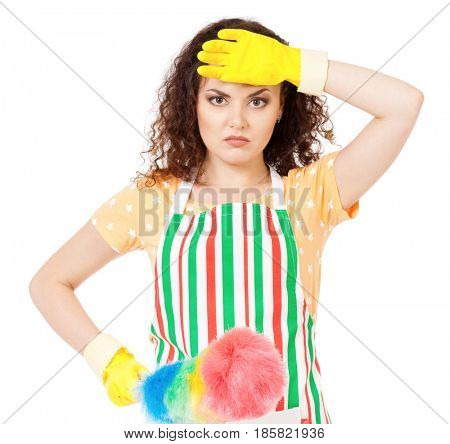 Tired young housewife with yellow gloves holding duster - isolated on white background